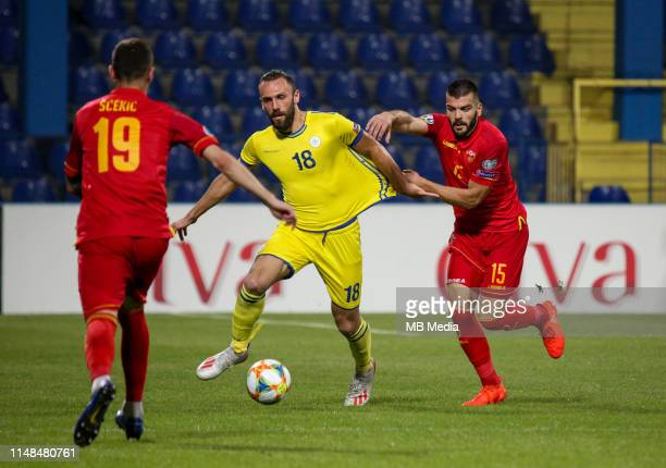 Vedat Muriqi of Kosovo and Igor Vujacic of Montenegro during the 2020 UEFA European Championships group A qualifying match between Montenegro and...