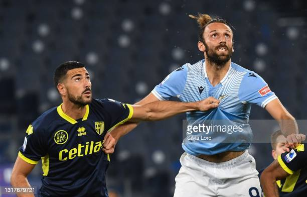 Vedat Muriqi of SS Lazio compete for the ball with Graziano Pellè of Parma Calcio during the Serie A match between SS Lazio and Parma Calcio at...