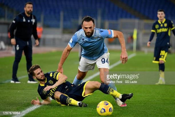 Vedat Muriqi of SS Lazio compte for the ball with Juan Giacomo Ricci during the Coppa Italia match between SS Lazio and Parma Calcio at Olimpico...