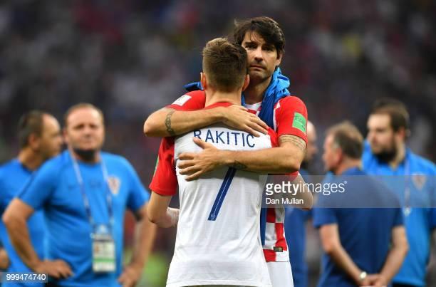 Vedran Corluka and Ivan Rakitic of Croatia look dejected following the 2018 FIFA World Cup Final between France and Croatia at Luzhniki Stadium on...