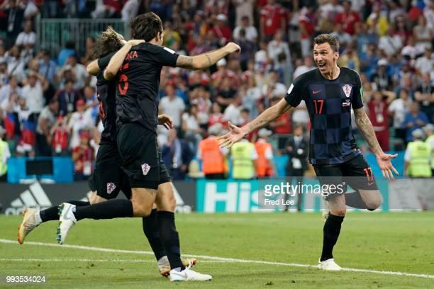 Vedran Corluka, Luka Modric and Mario Mandzukic of Croatia celebrate winning the penalty shoot out during the 2018 FIFA World Cup Russia Quarter...