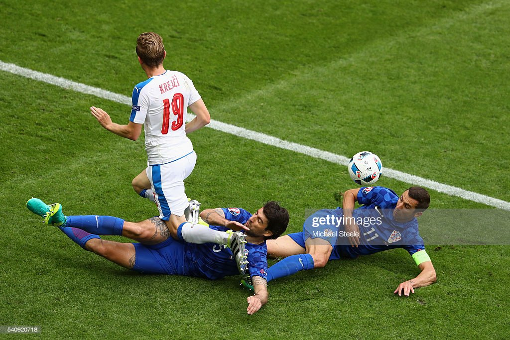 Vedran Corluka of Croatia and Darijo Srna of Croatia make a tackle on Ladislav Krejci of Czech Republic during the UEFA EURO 2016 Group D match between Czech Republic and Croatia at Stade Geoffroy-Guichard on June 17, 2016 in Saint-Etienne, France.