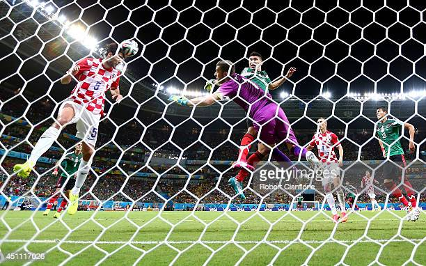Vedran Corluka of Croatia clears the ball off the line during the 2014 FIFA World Cup Brazil Group A match between Croatia and Mexico at Arena...