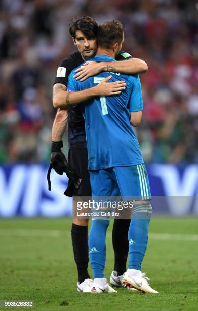 Vedran Corluka of Croatia consoles Igor Akinfeev of Russia following Russia's defeat in the penalty shoot out during the 2018 FIFA World Cup Russia...