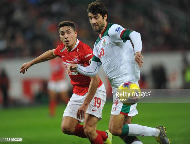 Vedran Corluka of FC Lokomotiv Moscow and Ezequiel Ponce of FC Spartak Moscow vie for the ball during the Russian Football League match between FC...