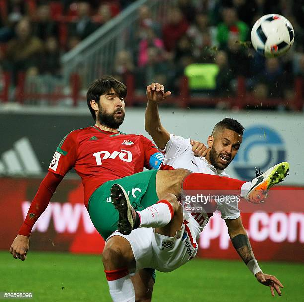 Vedran Corluka of FC Lokomotiv Moscow and Romulo of FC Spartak Moscow vie for the ball during the Russian Football League match between FC Lokomotiv...