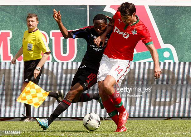 Vedran Corluka of FC Lokomotiv Moscow is challenged by Ahmed Musa of PFC CSKA Moscow during the Russian Premier League match between FC Lokomotiv...
