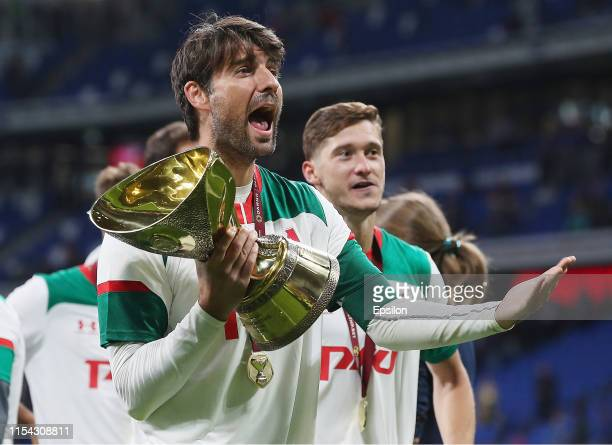 Vedran Corluka of FC Lokomotiv Moscow poses with the trophy as Lokomotiv Moscow celebrate victory in the Super Cup of Russia 2019 match between FC...