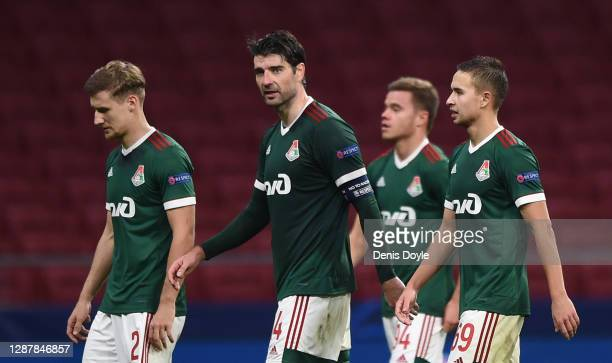 Vedran Corluka of Lokomotiv Moscow leaves the field with teammates at end of the UEFA Champions League Group A stage match between Atletico Madrid...