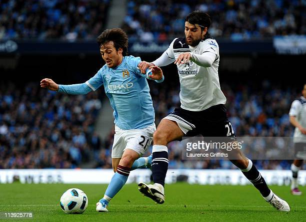 Vedran Corluka of Tottenham Hotspur challenges David Silva of Manchester City during the Barclays Premier League match between Manchester City and...