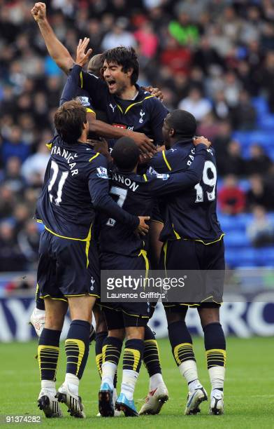Vedran Corluka of Tottenham Hotspur is congratulated on scoring the second goal to equalise during the Barclays Premier League match between Bolton...