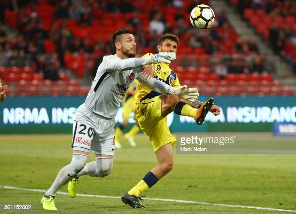 Vedran Janjetovic of the Wanderers and Daniel De Silva of the Mariners contest possession during the round two ALeague match between the Western...