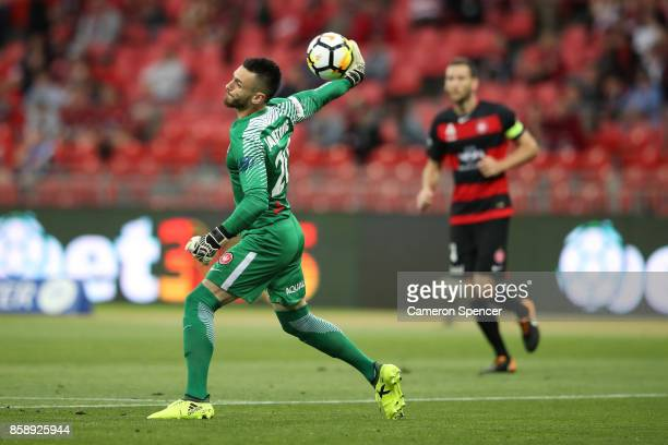 Vedran Janjetovic of the Wanderers passes the ball during the round one ALeague match between the Western Sydney Wanderers and the Perth Glory at...