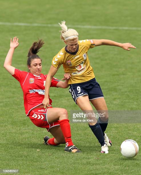 Vedrana Popovic of Adelaide is pushed off the ball by Sasha McDonnell of the Jets during the round one WLeague match between Adelaide United and...