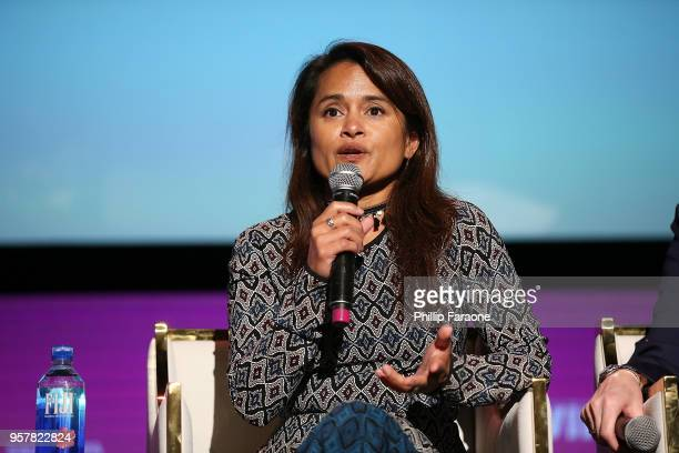 Veena Sud speaks onstage at the Netflix Rebels and Rule Breakers For Your Consideration Event at Netflix FYSee Space on May 12 2018 in Beverly Hills...