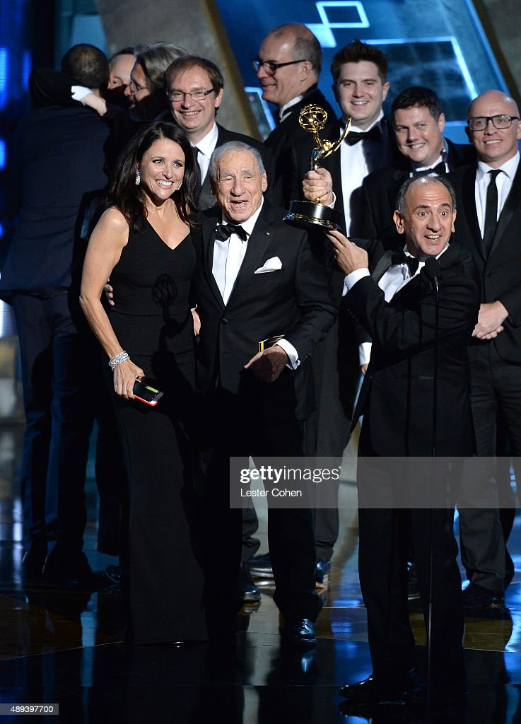 'Veep' actress Julia Louis-Dreyfus (L) accepts an award from entertainer Mel Brooks onstage during the 67th Annual Primetime Emmy Awards at Microsoft Theater on September 20, 2015 in Los Angeles, California.
