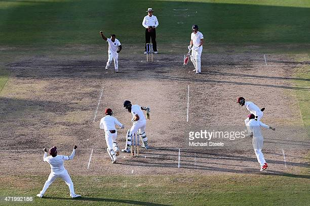 Veerasammy Permaul of West Indies celebrates bowling Moeen Ali of England during day two of the 3rd Test match between West Indies and England at...