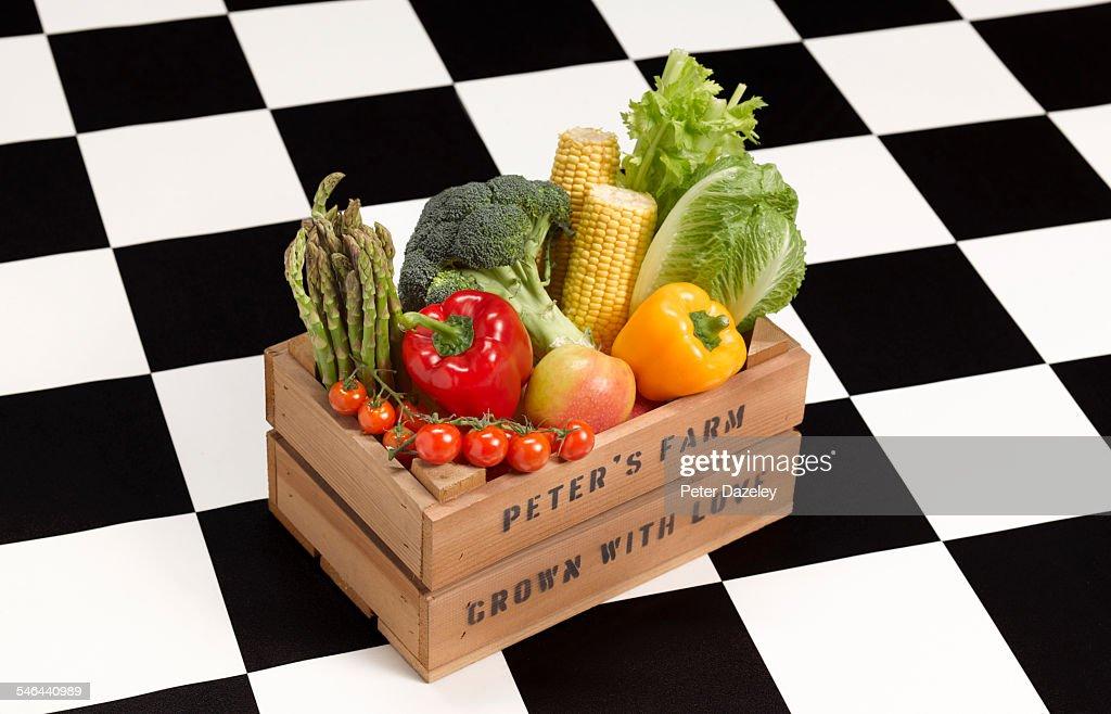 Veg box on kitchen floor : Stock Photo