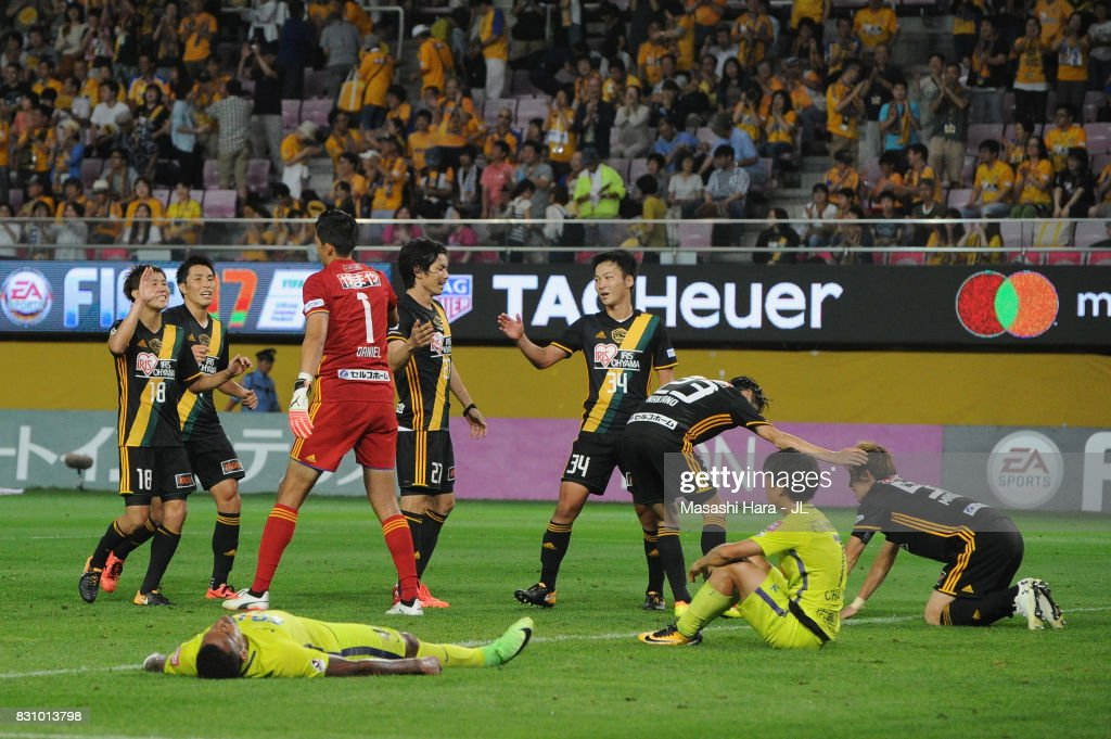 Vegalta Sendai players celebrate while Anderson Lopes and Yusuke Chajima of Sanfrecce Hiroshima show dejection after the J.League J1 match between Vegalta Sendai and Sanfrecce Hiroshima at Yurtex Stadium Sendai on August 13, 2017 in Sendai, Miyagi, Japan.