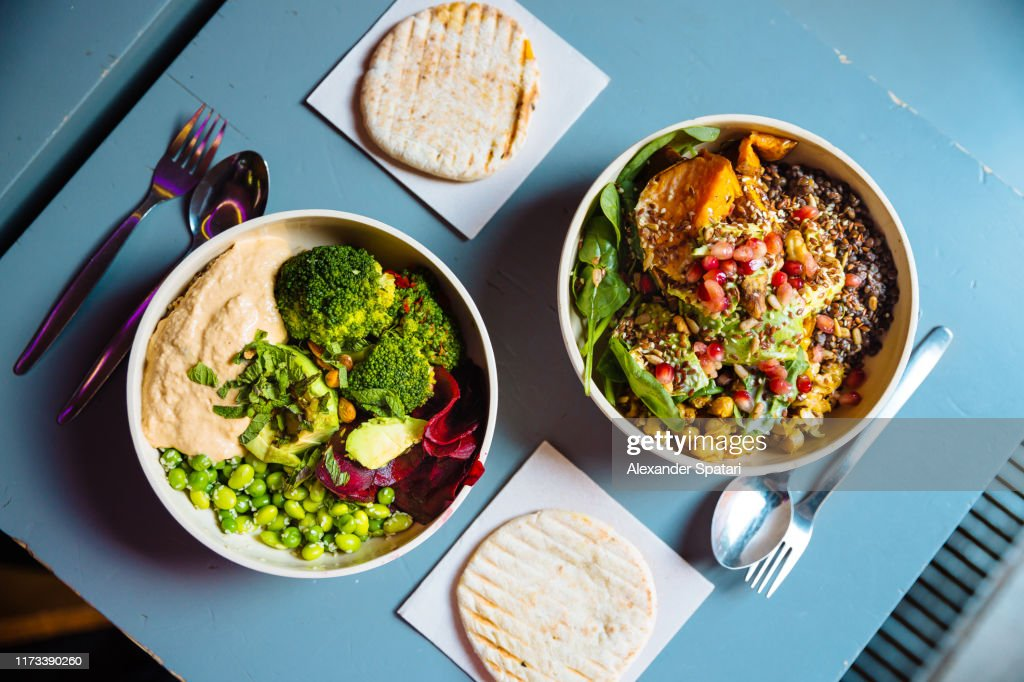 Vegan bowls with various vegetables and seeds, high angle view : Stock Photo