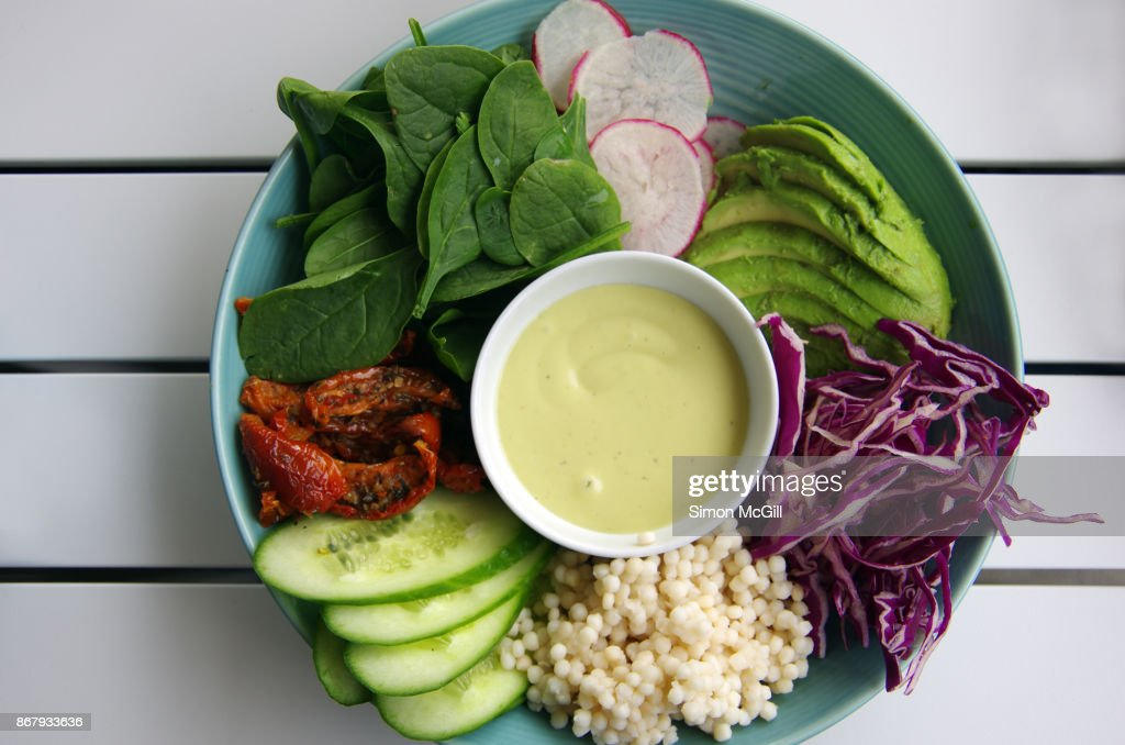 Vegan Breakfast Of Pearl Couscous And Raw Vegetables Cucumber Sundriedtomatoes Baby Spinach Radish Avocado And Red Cabbage With Aioli High Res Stock Photo Getty Images
