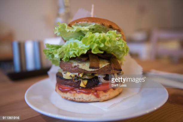 A vegan burger is displayed at the vegan seitan manufactory shop and diner L'herbivore by owner Johannes Theuerl on January 25 2018 in Berlin Germany...