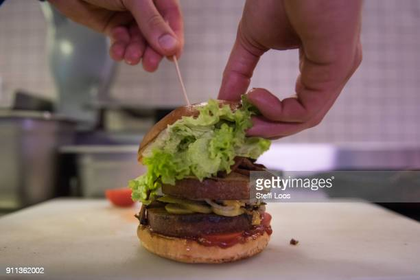 Vegan burger is displayed at the vegan seitan manufactory shop and diner L'herbivore by owner Johannes Theuerl on January 25, 2018 in Berlin,...