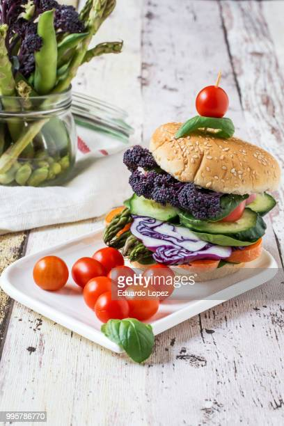 vegan burger with fresh vegetables - lopez stock pictures, royalty-free photos & images