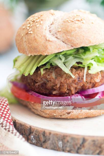 vegan burger with rice - veggie burgers stock pictures, royalty-free photos & images