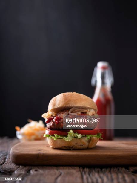 vegan burger with slaw and vegan ketchup. - burger stock pictures, royalty-free photos & images