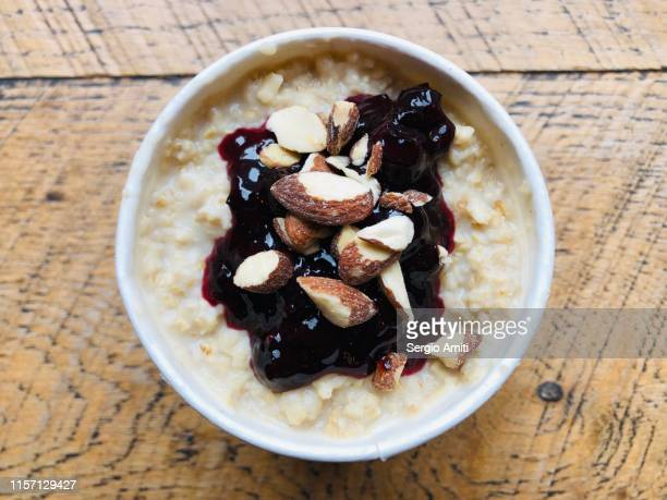 Vegan coconut 5-grain porridge pot, berry compote and salted almonds