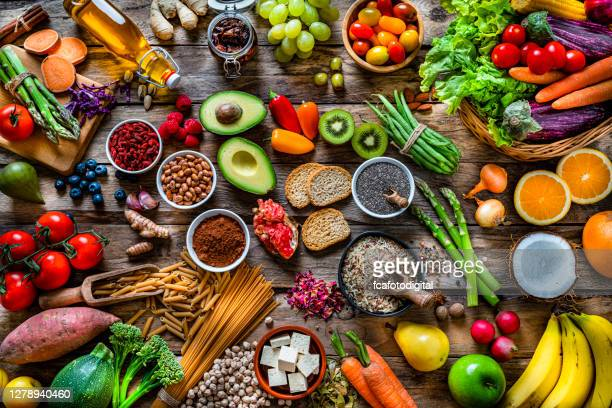 vegan food backgrounds: large group of fruits, vegetables, cereals and spices shot from above - nut food stock pictures, royalty-free photos & images
