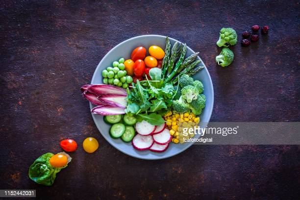 vegan food: healthy fresh vegetables salad shot from above - raw food diet stock pictures, royalty-free photos & images