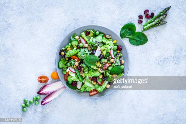 vegan food: healthy fresh vegetables salad shot from above - salad stock pictures, royalty-free photos & images