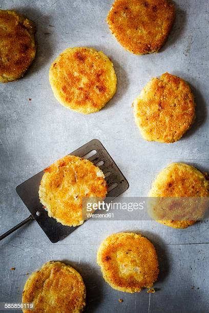 Vegan fritters made of millet and mung beans on baking tray