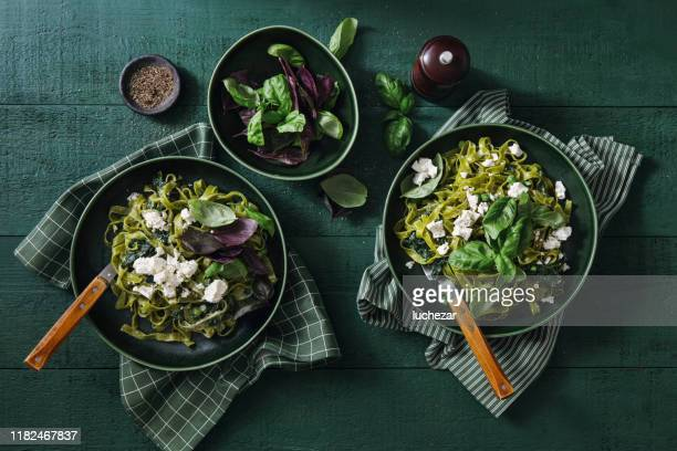 vegan gluten-free creamy spinach pasta - salad stock pictures, royalty-free photos & images