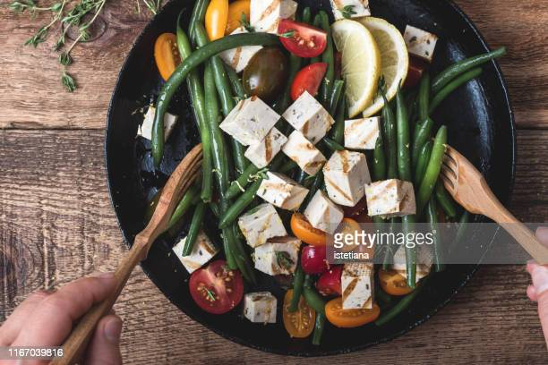 vegan meal, cooking green beans salad with grilled tofu - veganism stock pictures, royalty-free photos & images