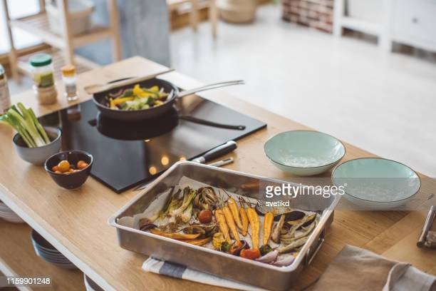 vegan meal - electric stove burner stock pictures, royalty-free photos & images