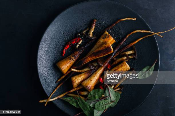 vegan meal, plant based food, roasted parsley root with mushrooms - gourmet stock pictures, royalty-free photos & images