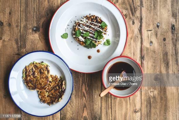 vegan okonomiyaki pancakes, toppings and okonomi sauce - おかず系 ストックフォトと画像