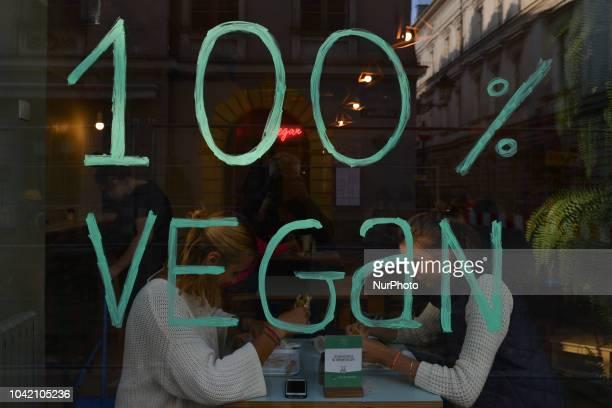 100% vegan on a window of one of many vegan restaurants in Krakow city center On Thursday September 27 in Krakow Poland
