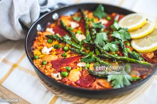 vegan paella - gourmet stock pictures, royalty-free photos & images