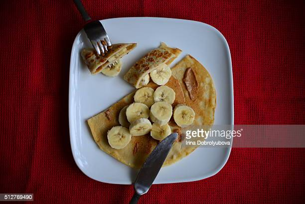 vegan pancakes with nut butter and banana