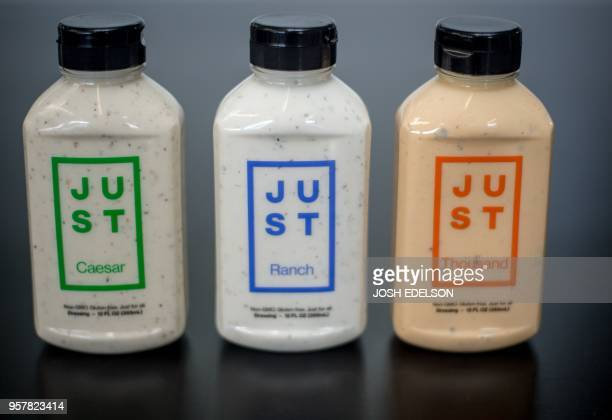 Vegan salad dressings are seen on display at Just headquarters office in San Francisco California on May 4 2018 Just who develops vegan products...