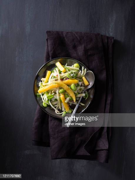 vegan salad with edamame and mango. - plate stock pictures, royalty-free photos & images
