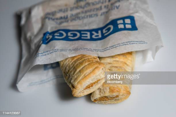 Vegan sausage rolls from a Greggs Plc sandwich chain outlet sit in a bag in this arranged photograph in London, U.K., on Wednesday, May. 15, 2019....