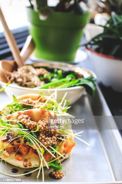 vegan steamed bao buns and ramen - mmeemil stock photos and pictures