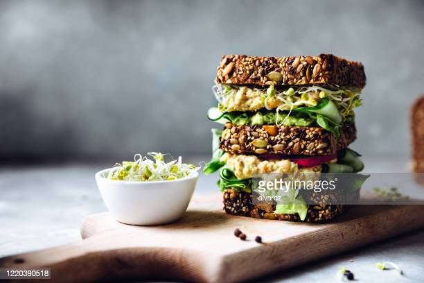 vegan super sandwich served with sprouts - artisanal food and drink stock pictures, royalty-free photos & images