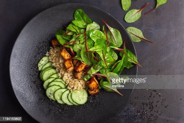 vegan tofu poke bowl with baby chard and quinoa - vegetarianism stock pictures, royalty-free photos & images