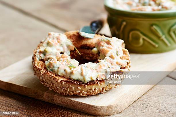Vegan vegetable cream cheese spread with carrots, onions, celery and herbs on a toasted bagel